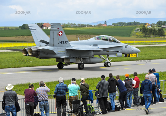 Spotters watching a  McDonnell Douglas F/A 18C Hornet figher jet of the Swiss Air Force
