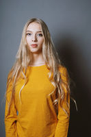 serene teenage girl with very long blond hair