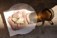 Typical tyrolean snack meal. Ham sandwich with apple cider or must. Originally called Brettljause wi