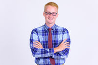 Happy young blonde businessman smiling with arms crossed