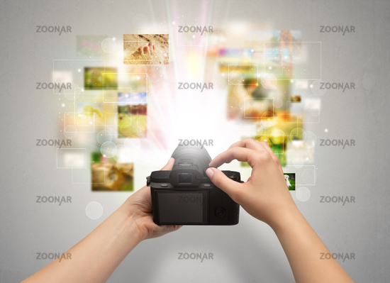 Hand captures life events with digital camera