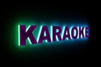 word KARAOKE with neon light