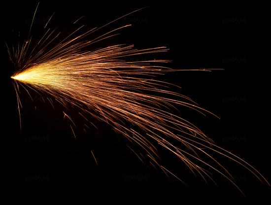 Bright fiery sparks in dark