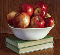 Vase with apples and books