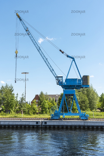 blue building crane, Ziegelsee lake, Schwerin, Mecklenburg-Western Pomerania, Germany, Europe