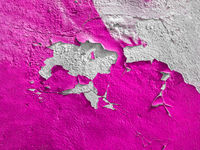 Pink wall with the peeled-off paint