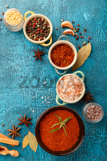 Spices and condiments in small bowls