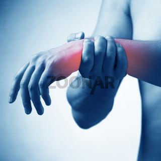 Man suffering from acute pain in wrist