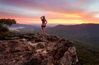 Adventurous female watching the sunset after a long day hiking in Blue Mountains