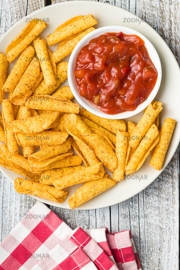 Rolled mexican nacho chips and salsa dip.