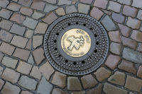 Manhole cover with a dove of peace