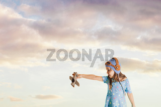 Fascinated girl with a toy airplane imagining her future profession