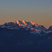 Snow capped mountain Blüemlisalp at sunrise. View from Mount Niederhorn. Bernese Oberland, Switzerla