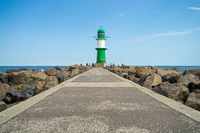 Lighthouse in front of the entrance to the waters of the sea port of Rostock - Warnemuende.