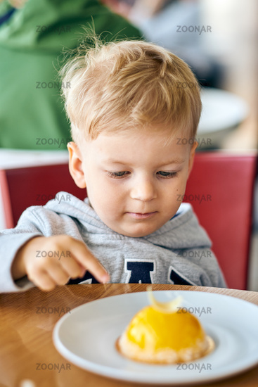 Boy eating dessert in cafe