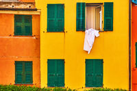 Windows of colorful  houses and airing linen
