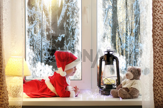 A child in the new year looks out the window. Children are waiti