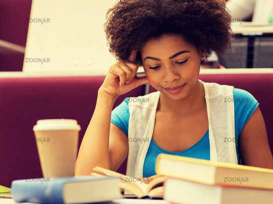 student girl with books and coffee on lecture