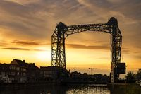 Willebroek, Belgium - May 27, 2019:  The iron drawbridge over the Brussels-Scheldt canal in Willebroek by sunset