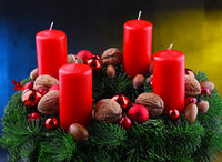 Traditional Advent Christmas decoration with spruce and candles.