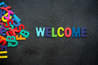 Welcome text on dark background.