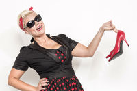 Rockabilly lady presents red high heels