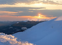 Sunset in winter mountain
