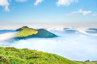 Green mountain in the clouds