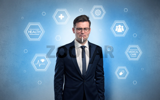 Sick businessman with medical care concept
