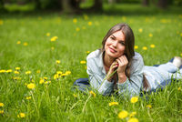 Woman laying on grass in park