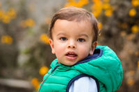 Outdoor portrait of mixed raced toddler