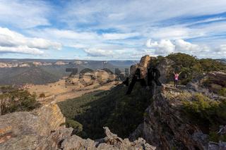 Adventurous hiker explorer reaching the top slab of Donkey Mountain