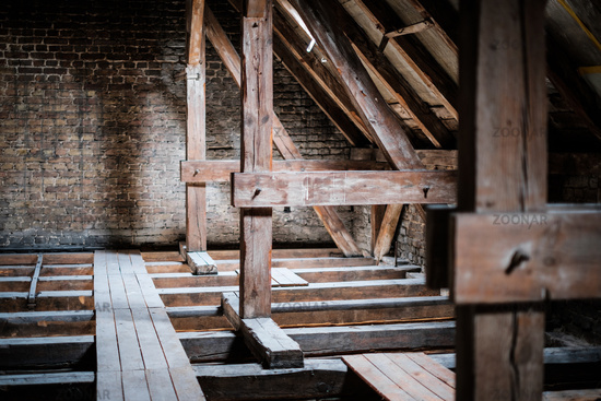 roof beams in old, empty attic / loft before renovation / construction concept