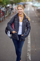 Portrait of young blond woman in the street