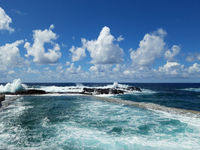waves at coast with ocean horizon and blue sky and sunny weather -