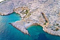 Island of Krk idyllic pebble beach with karst landscape aerial view, stone deserts of Stara Baska