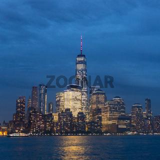 Panoramic view of Lower Manhattan from Ellis Island at dusk, New York City.