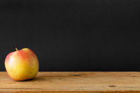 black background apple wooden table