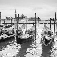 Venetian lagoon with moored gondolas