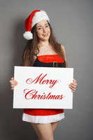 merry christmas woman dressed in xmas costume and santa hat