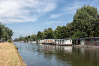 Dutch canal in city Utrecht with moored houseboats