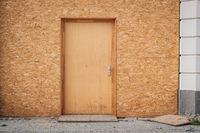 Temporary entrance door , wooden door made of chipboard  -