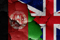 flags of Afghanistan and UK painted on cracked wall