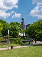 People enjoy the fine weather in public park in Hamburg.