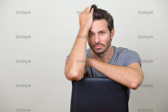 Studio shot of handsome bearded man brushing hair back