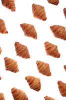 Diagonal bakery french croissants pattern on a white background.