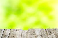 Wooden deck and blur green grass