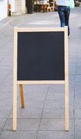 empty customer stopper blackboard sign standing on sidewalk