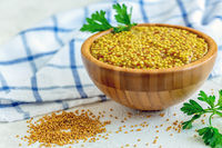 Bowl with grain mustard close-up.