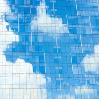 Blue sky reflection on office building